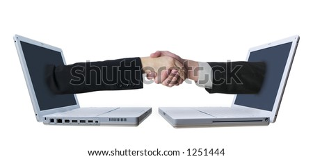 Arms reaching from laptop screens to shake hands in a conceptual shot representing connections and networking.
