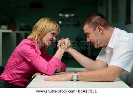 armwrestling in the office. girl vs guy - stock photo