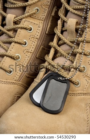 army deployment  military desert boots and tag chains, when the time comes our soldiers are ready. - stock photo