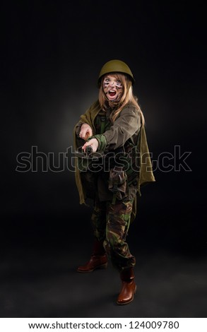 army girl attack shovel, soldier woman in a military uniform full ...
