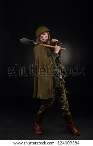 army girl hold shovel, soldier woman in a military uniform full length ...