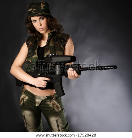 Army girl posing with paintballgun
