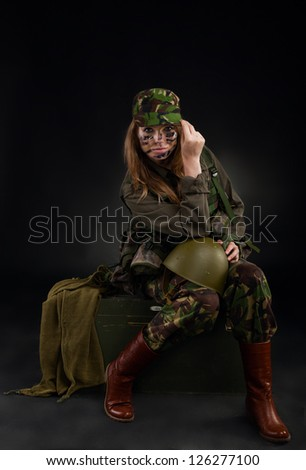 army girl, soldier woman sitting hold helmet wear military camouflage ...