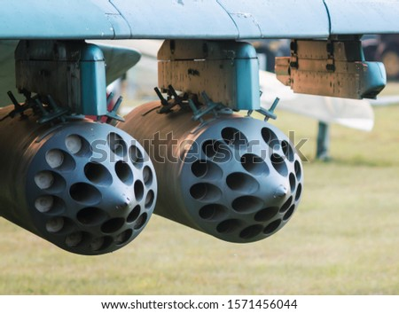 army military rocket launcher on the wing of an airplane close up