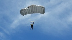 ARMY SOLDIER ON EXERCISE OPERATION PARACHUTE , BLUE SKY CLOUD BACKGROUND
