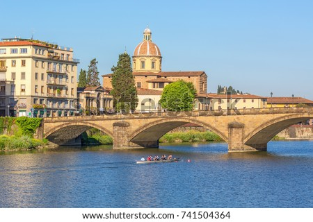 Arno River in Florence with a rowboat
