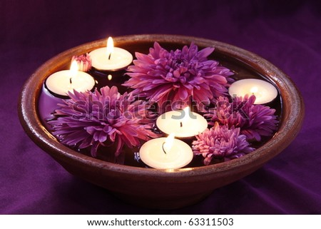 Aroma Bowl with Candles and Flowers on Violet