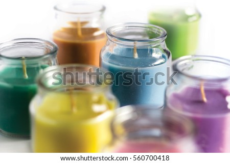 Aroma candles with colorful wax. #560700418
