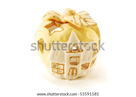 Aroma lamp in the form of winter house is isolated on a white background