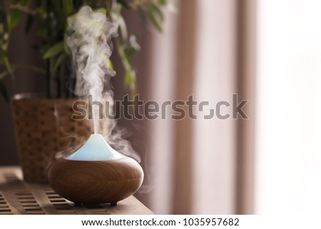 Aroma lamp on table #1035957682