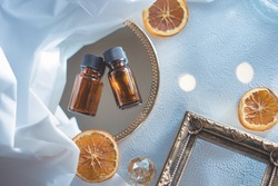 Aroma material. Two bottles of aroma oil. Dried fruit orange.