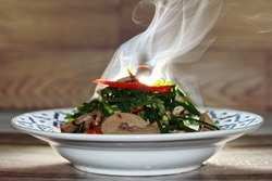 Aroma of spicy fried Chinese chives with chicken spleen.
