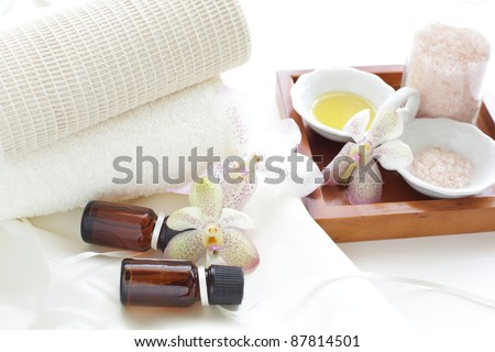 Aroma oil and massage salt with towel neatly