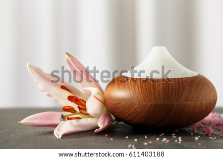 Shutterstock Aroma oil diffuser and flower on table