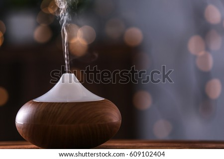 Shutterstock Aroma oil diffuser on blurred background