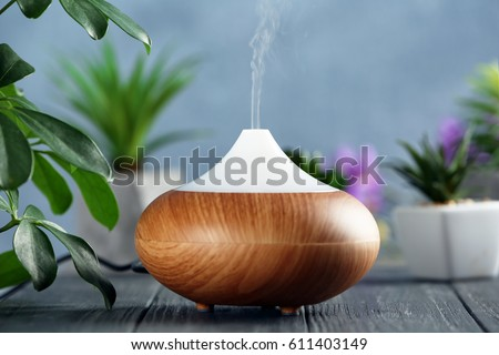 Shutterstock Aroma oil diffuser on wooden table
