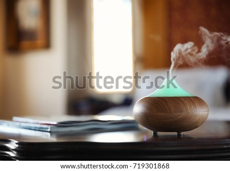 Shutterstock Aroma oil diffuser on wooden table in room