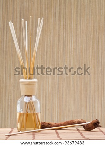 Aroma sticks in bottle against pattern background