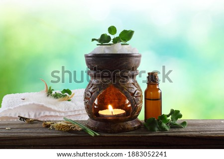 aroma therapy aromatic Essential oil diffuser aroma lamp with herb and oil bottle for cosmetics, spa, health, nature concept Stock foto ©