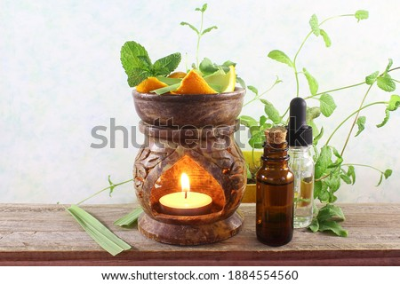aroma therapy aromatic Essential oil perfume bottles with aroma lamp and herb for aroma therapy,medical,cosmetics, spa, health, nature concept  Stock foto ©