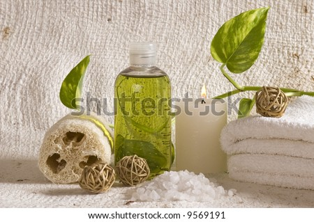 aroma therapy objects. bottle of esential oil, candles, bath-salt, towels.