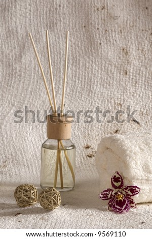 aroma therapy objects. bottle of esential oil, candles, bath-salt, towels, orchid