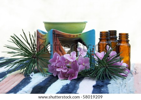 Aromatherapy Aroma Oil in Glass Bottles and Candle Bowl Decorated