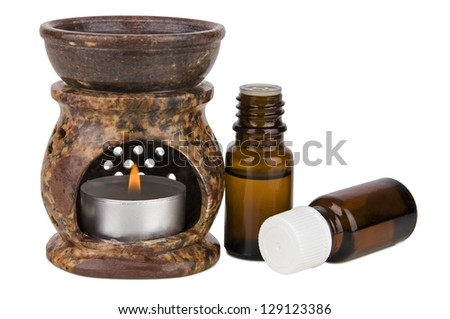 Aromatherapy lamp and oils isolated on white