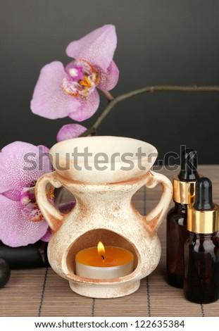 Aromatherapy lamp on grey background