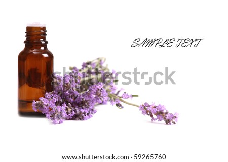 Aromatherapy oil and lavender flower isolated on white background