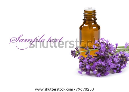 Aromatherapy oil and lavender flowers isolated on white background