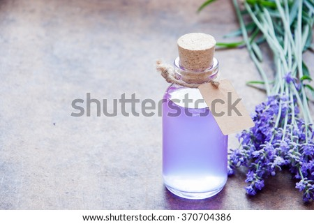Aromatherapy oil and lavender, lavender spa, Wellness with lavender, lavender syrup on a wooden background