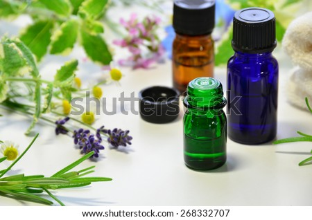 aromatherapy oils with herbal flowers