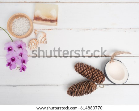 Aromatherapy  product  Spa set ,candle ,soap,coconut orchid flower,shell,  massage  with white wood  background . top view composition. #614880770