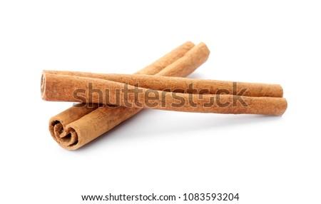 Aromatic cinnamon sticks on white background