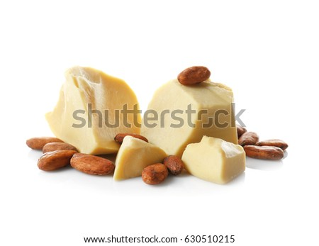 Aromatic cocoa beans and butter on white background #630510215