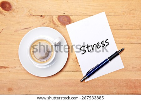 aromatic coffee on wood table with notepad and pen - stress
