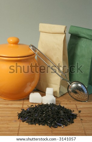 Aromatic flower tea leaves, sugar and strainer