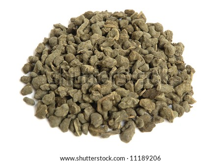 Aromatic green tea leaves with ginseng on white background