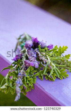 Aromatic herbs bunch on wooden table