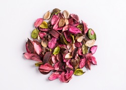 Aromatic mix of potpourri of dried flowers. A bunch of dry potpourri flowers on a white background.
