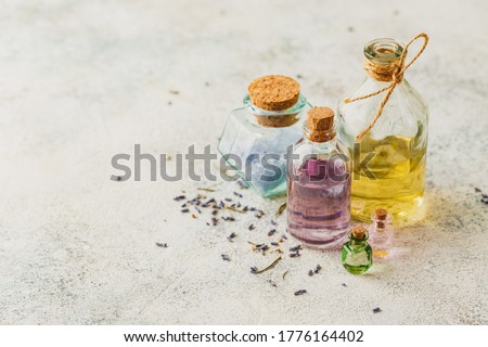 Aromatic oils in glass bottles and dry lavender. Concept natural ogranic skincare cosmetic. Photo stock ©