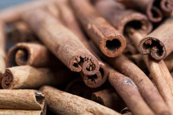 aromatic solid cinnamon used to make aromatic and delicious spices for baking rolls and cooking other dishes, close-up of whole cinnamon sticks from the bark of a tree