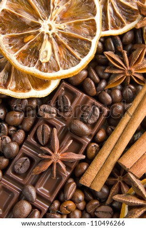 Aromatic spices with coffee and chocolate background