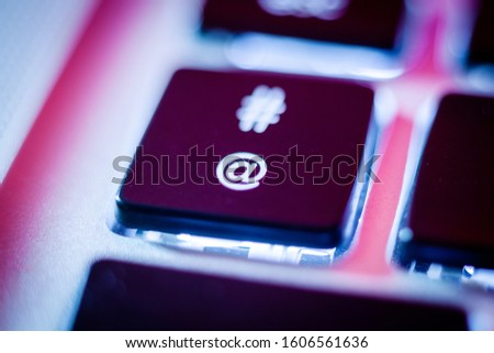 Around or at sign key on computer keyboard close up Сток-фото ©