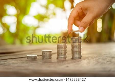Arrange coins into heaps with hands, content save money