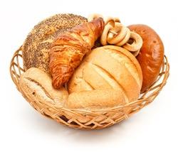 Arrangement of bread in basket on white background