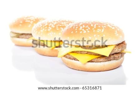 arrangement of cheeseburger and hamburger isolated on white