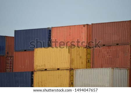 arrangement of containers of different colors