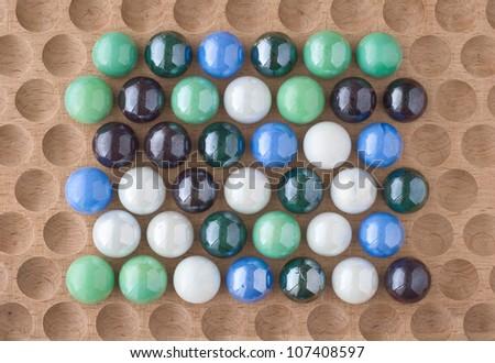 Arrangement of Marbles as Design Elements on Wood